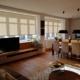 Textilní rolety pro rekonstruované patro rodinné vily obývací pokoj